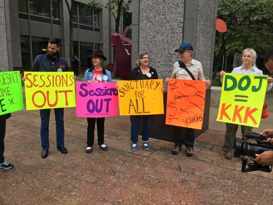Protesters outside of the U.S. Attorney's office in