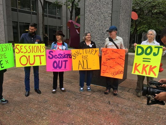 Protesters outside of the U.S. Attorney's office in Austin while U.S. Attorney General Jeff Session speaks inside.