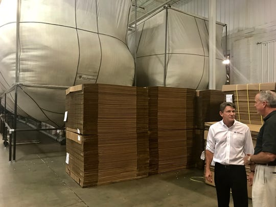 Republican gubernatorial candidate Randy Boyd met with business leaders in Marshall County, including receiving a tour of Comfort Research, a bean bag chair manufacturer in Lewisberg by plant manager Will Wilson. In the background is large storehouse of the beans that go into the bean bag chairs.