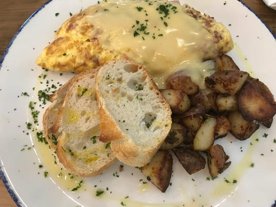 Cheesy omelette lorraine with french bread and potatoes