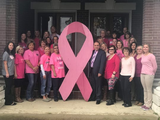 Cheatham County Mayor Kerry McCarver and staff gather