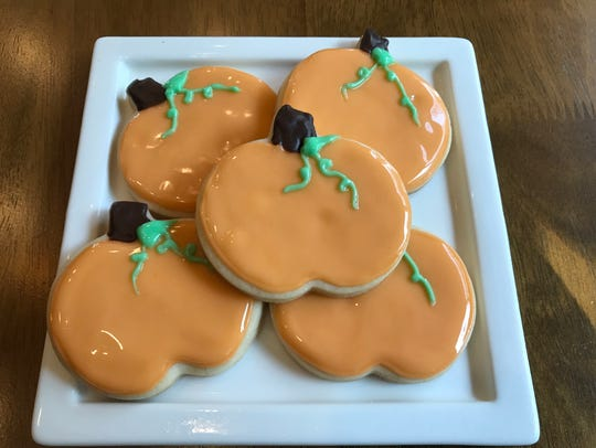 Pumpkin-shaped cut-out cookies are a classic Halloween