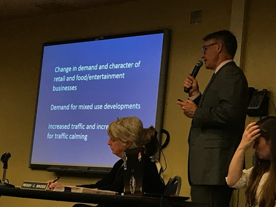 Mayor Corby gives a presentation on what the proposed moratorium is during the public board meeting on Oct. 24