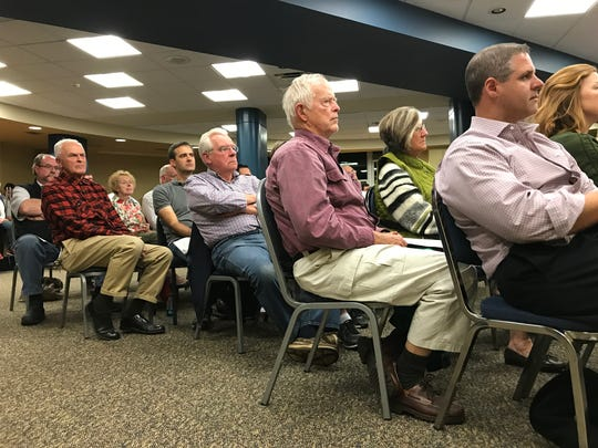 Residents listen as a proposed moratorium is discussed during a Pittsford village board meeting on Oct. 24.