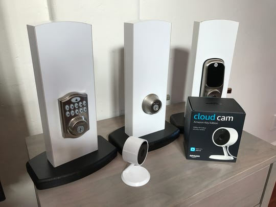 Three varieties of smart locks that work with the Amazon Key in-home delivery service. They are from Kwikset and Yale. Also shown is the Amazon Cloud Cam video camera.