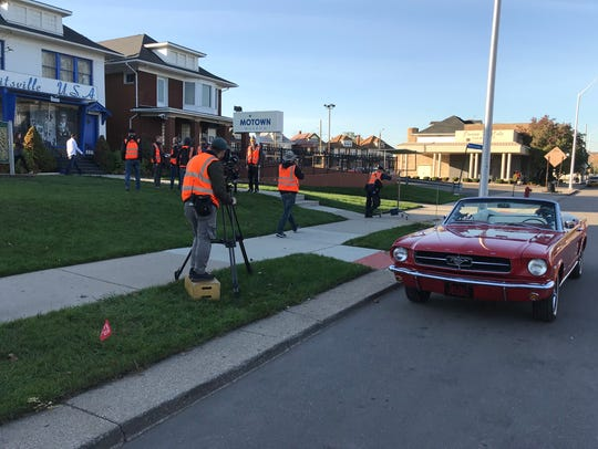 A film crew shoots George Magro's Mustang.