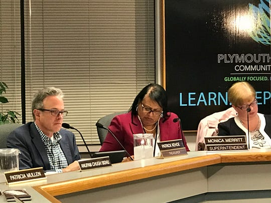 Plymouth-Canton Community Schools Treasurer Patrick Kehoe (from left), Superintendent Monica Merritt and board member Kate Borninski are pictured from a school board meeting.