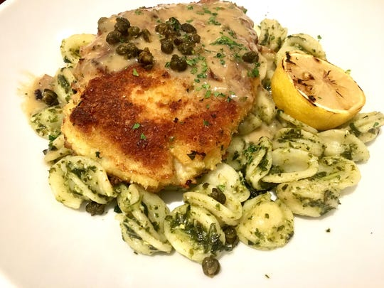 The chicken picatta ($21) includes a parmesan-crusted chicken breast, fresh Orecchiette pasta, basil pesto and capers.