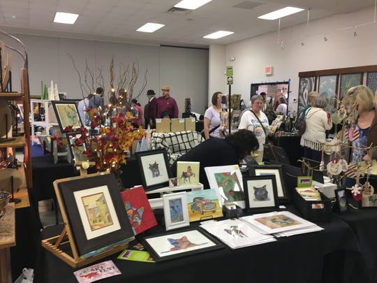 Attendees check out Temple Israel Art Fest on Nov. 13, 2016.