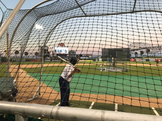 A Hooks season-ticket holder takes batting practice with the World Series opening ceremonies on in the background on Tuesday Oct. 24 at Whataburger Field.