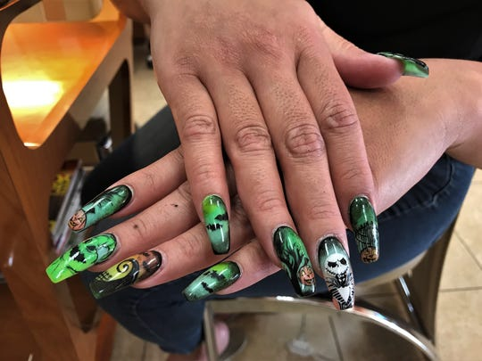 "The ""Nightmare Before Christmas"" themed nails all started with a dare by Michelle Bazan's husband."