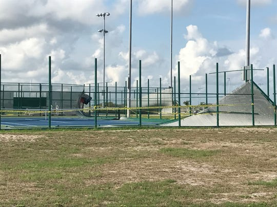 The tennis courts at Veterans Memorial High School suffered significant damage from Hurricane Harvey.