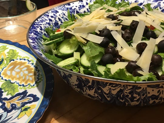 An Italian salad with shaved Parmesan and lots of black olives was on the menu at a KitchenAble cooking class.