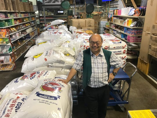 Union Oriental Market owner Vue Yang stands among the