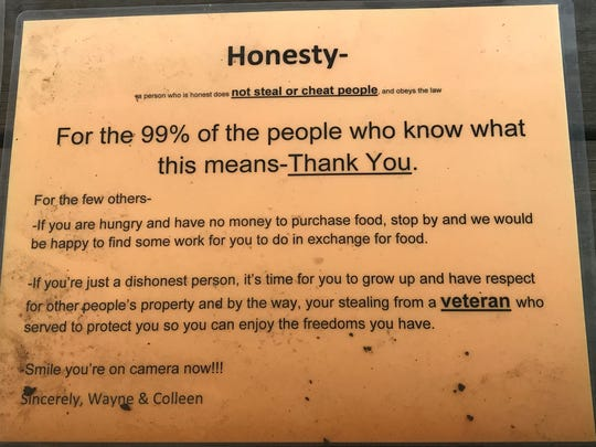Wayne and Colleen Lubbert placed this sign on their rural Fond du Lac roadside stand after having trouble with dishonest people.