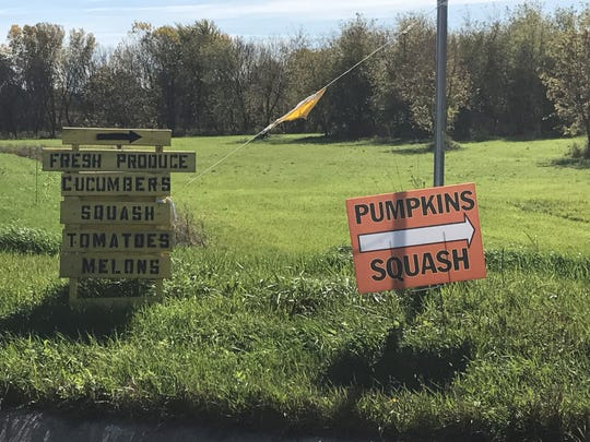 Signs pointing towards roadside produce stands have popped up all across the state during the summer and fall harvest seasons.