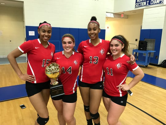 Twinning and winning: Elmwood Park's two sister duos played a key role in the team's second straight NJIC volleyball tournament title. From left, Chantel Charles, Maria Coello, Charelle Charles and Rosemary Coello.