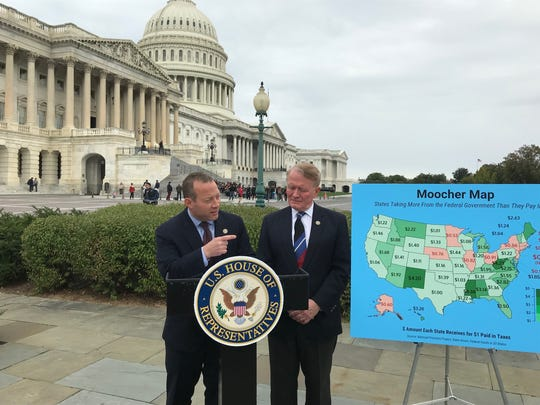 "Rep. Josh Gottheimer, D-Wyckoff, points to a map showing ""moocher"" states that get more federal dollars than they pay in taxes, as he and Rep. Leonard Lance, R-Clinton Township, announce a bill Oct. 26 to give tax credits to people in ""payor"" states."