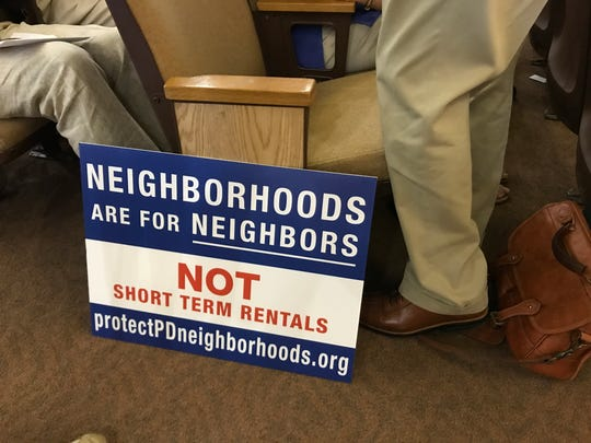 "Opponents to short-term rentals came to Palm Desert City Council on Thursday, Oct. 26, 2107, with signs proclaiming, ""Neighborhoods are for Neighbors, Not Short-Term Rentals."""