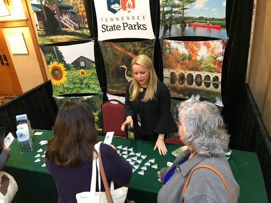 Morgan Gilman, from the Tennessee Department of Environment and Conservation, promotes the state park system to attendees at the Governor's Conference on Economic and Community Development.