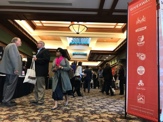 Participants in the Governor's Conference on Economic and Community Development stroll among more than a dozen vendors at the Gatlinburg Convention Center.