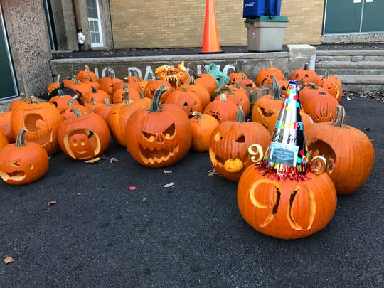 Even pumpkins dropped off for Forest Avenue School's Festival of Jack O'Lanterns include the Verona school's 90th anniversary spirit on Oct. 27, 2017.