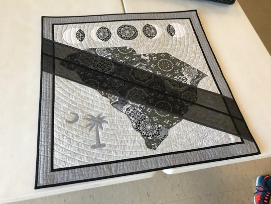 A quilt commemorating the solar eclipse that passed