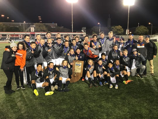 Harrison celebrates the 2017 Class 3A boys soccer state