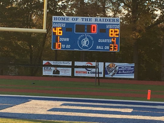 The scoreboard on Scotch Plains-Fanwood's athletic field still displays the high school's old logo of a geometric figure