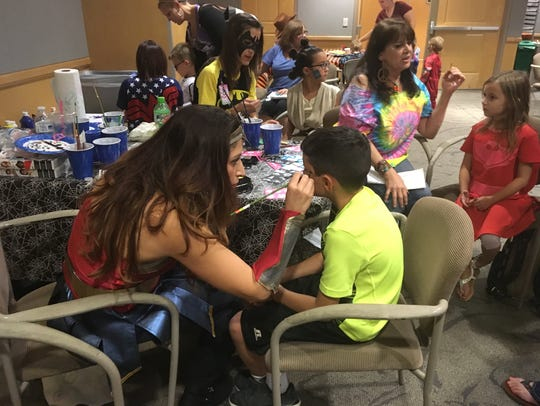 Children of all ages lined up to get their faces painted