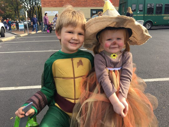 Grottoes residents Easton Puffenbarger, 5, and Layna Puffenbarger, 2, pose for a photo at the Halloween downtown trick-or-treating event in Staunton, Va., on Saturday, Oct. 28, 2017.