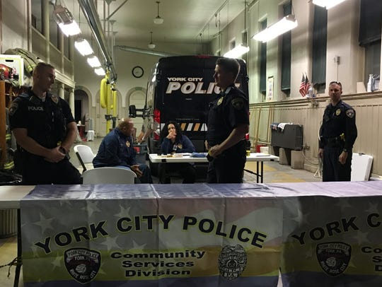 York City Police officers collect guns brought in for