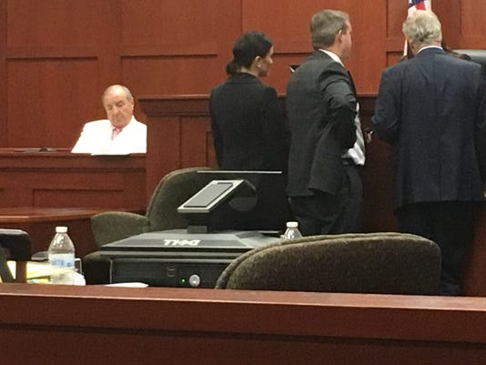 Joe Caruso waits while prosecutors Laura Moody and William Respess and defense attorney Warren Lindsey confer with Judge Marlene Alva.
