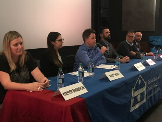 Six write-in candidates for South Lyon mayor -- Kennyson Borkowski (from left), Ashley Enstad, Daniel Pelchat, William Powell, Richard Vessella and Brandon Yopp -- spent two hours answering questions at a candidate forum Sunday.