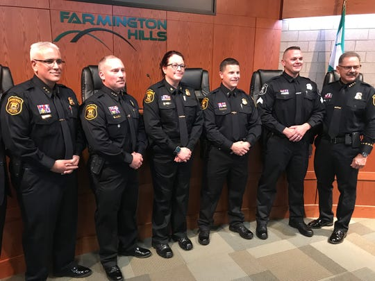 Farmington Hills Police Chief Charles Nebus (right) poses with 111 years worth of experience in promotees Daniel Rodriguez, Jeff King, Bonnie Unruh, Richard Blendea and Mark Jelley.