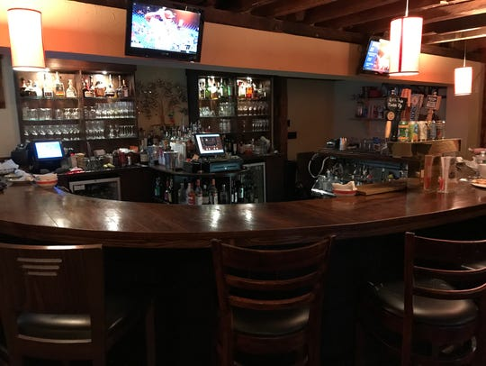 The bar at Twisted Elm, a small tavern serving a rotating