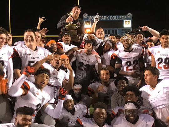 Ventura College football coach Steve Mooshagian sits on players shoulders after the Pirates won the 50th Citrus Cup game at Moorpark College last season.