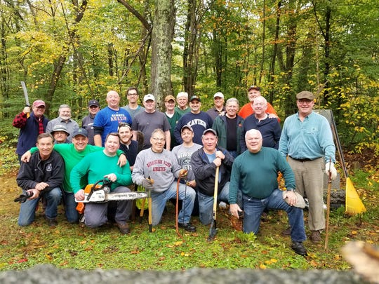 Members of the Friendly Sons of Saint Patrick of Morris County worked with other community organizations to clean up and restore St. Patrick's Cemetery in Hibernia.