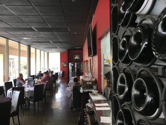 Wine bottles are seen in the dining room at Bistro
