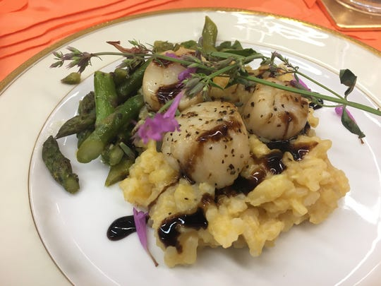 White Wine Scallops with a Pumpkin Risotto and topped with a Balsamic Reduction by Caspiana Catering.