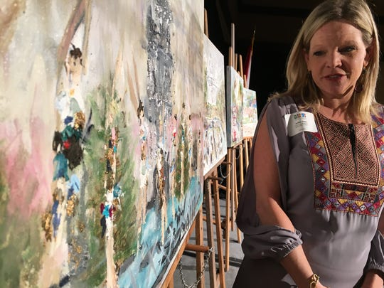 Artist Amber Ivey Bostwick created the mixed-media artworks that were given out as awards at Thursday's ceremony.