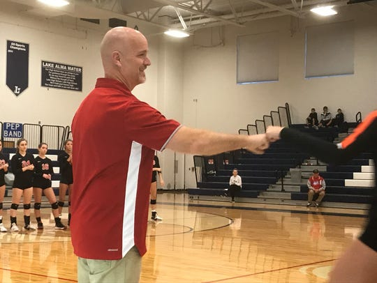 Pleasant volleyball coach Randy Haas greets a Coldwater