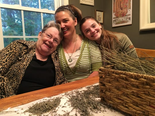 "In her Staunton home on Oct. 26, 2017, Nikki Narduzzi sits between her grandmother Diana Andes Solomon and daughter Maya Simmons. Diagnosed with Crohn's disease, Narduzzi is patient coalition director of Cannabis Commonwealth and played an integral role in ""Let Doctors Decide,"" the medical cannabis bill now heading to the governor's desk to be signed into law."