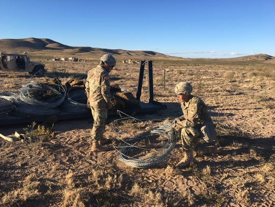 Soldiers with 1-77 Armor put up concertina wire to secure the battalion's battlefield headquarters area during platoon-level exercises last fall. The Steel Tigers and the rest of 3rd Brigade are preparing to go to the National Training Center at Fort Irwin, Calif., in late May and into June.