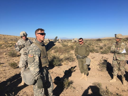 First Lt. Matt Hale, who was part of the opposing force during a recent platoon level exercise, talks to other soldiers in the 1-77 Armor during what is called the after-action review. This is where soldiers learn what they did well during the exercise and what they can improve on. It is considered the most important part of any training exercise.