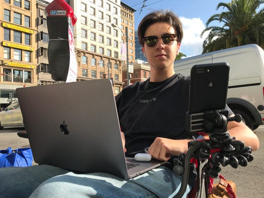 Colby Park, 19, waiting in line at Apple's flagship