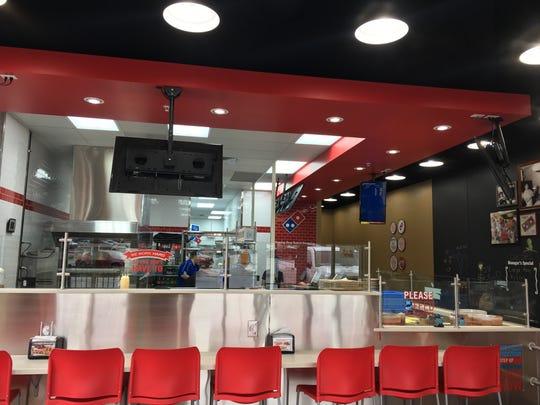The new Domino's Pizza,2448 University Ave., features the chain's remodeled look.