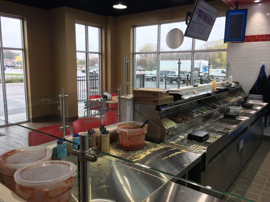 Domino's Pizza's remodeled locations, like this one at 2448 University Ave., offer dine-in space and allows customers to watch their order being made.