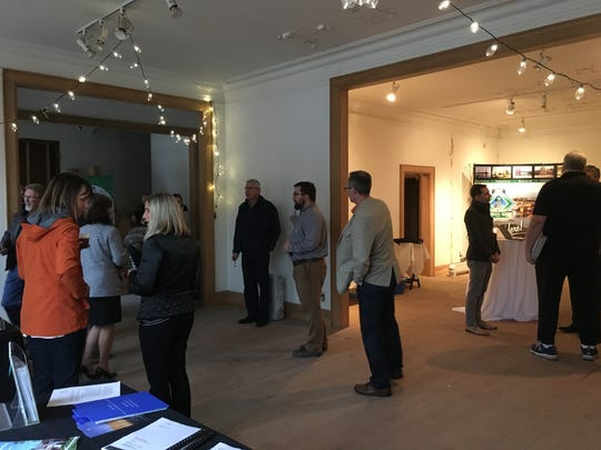 A few dozen people attended an open house at the historic Schauer and Schumacher buildings in downtown Green Bay on Nov. 2, 2017.