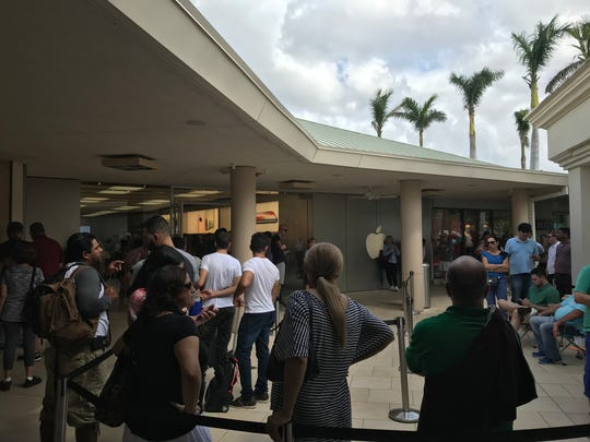 People wait outside the Waterside Shops in Naples for the iPhone X on Friday, Nov. 3, 2017.